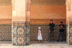 family observing tile work Marrakesh